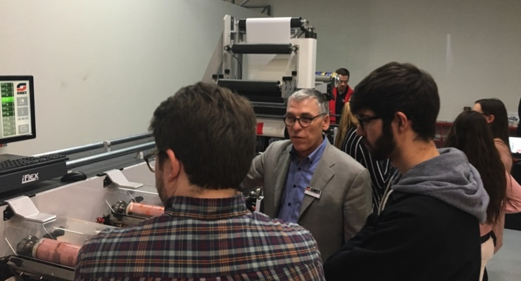 Claudio Semenza (center), of Omet Americas, Inc., explains flexo technology to students from Illinois State University.