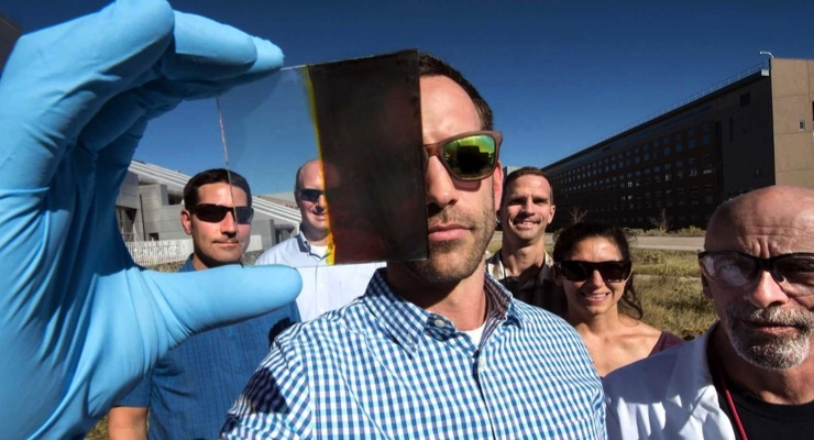 Lance Wheeler (front) developed a switchable photovoltaic window along with (from left) Nathan Neale, Robert Tenent, Jeffrey Blackburn, Elisa Miller, and David Moore. (Photo by Dennis Schroeder/NREL)