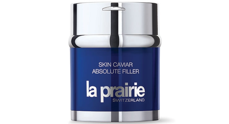 La Prairie developed an innovative airless pump system that preserves the formula from the environment. The lid opens to reveal the inverted button.