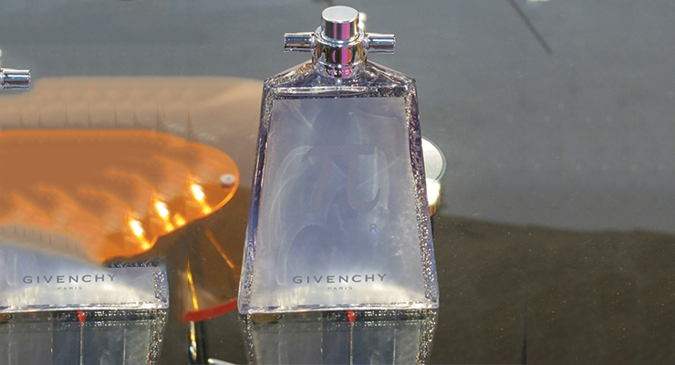 Givenchy's new fragrance highlights a new hot foil stamping deco technique from Piramal Glass.