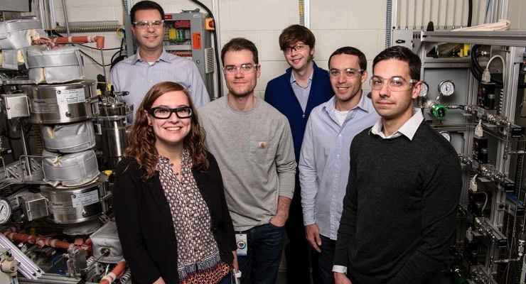 From left, Adam Bratis, Violeta Sànchez i Nogué, Todd Eaton, Gregg Beckham, Vassili Vorotnikov, and Eric Karp, part of the NREL team working on a cost-competitive, sustainable process for creating acrylonitrile and carbon fibers from renewable biomass. (Photo by Dennis Schroeder/NREL)