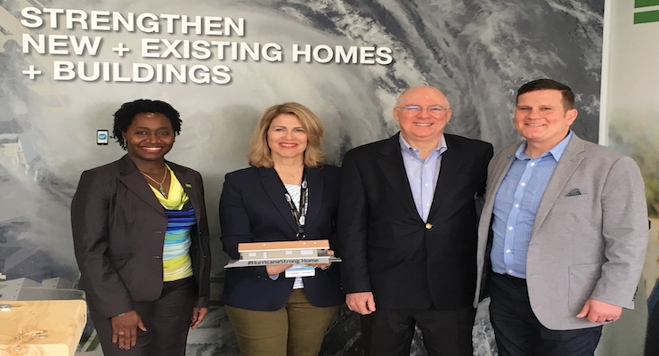 Leslie Chapman-Henderson, president and CEO of FLASH, presented the 3D model of the Breezy Point rebuild to Juan Carlos Ordonez, Senior Vice President of Performance Materials North America of BASF, for outstanding efforts in advancing the FLASH educational program, #HurricaneStrong.  (Courtesy BASF)