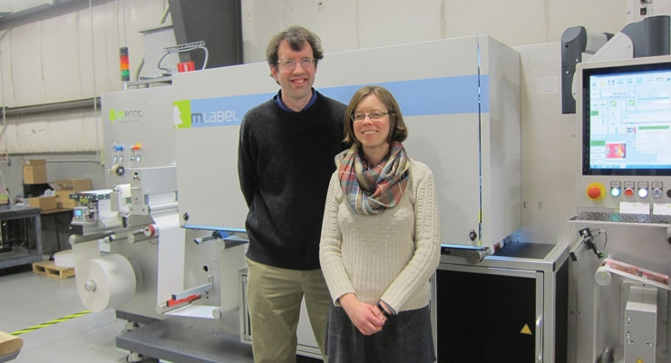 EIM owners Alex Henkel, president, and Heather Bell, vice president, with their new mLabel UV inkjet hybrid press from mprint.