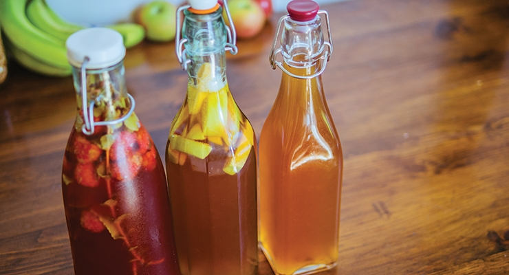 Pick your probiotic. Three bottles of kombucha tea—orange  blossom, raspberry mint and apple.
