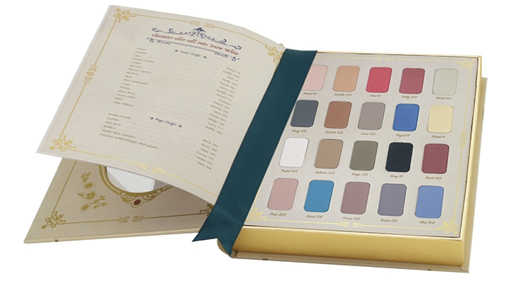 "To celebrate Snow White's 80th anniversary, Disney asked Bésame Cosmetics to build a collection honoring the beloved film. ""The 1937 Storybook Palette"" includes 20 eye shadows packaged in a magical fairy tale tome. An oval mirror is inset into the inside front cover. (For more on Bésame, go to BeautyPackaging.com)"