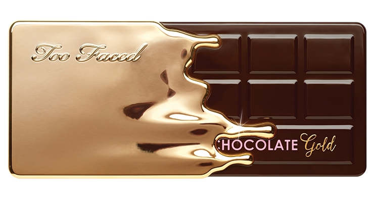 "For Too Faced's luxurious gold and cocoa powder infused eye shadow palette 'Chocolate Gold,' the brand ""dipped"" their original Chocolate Bar palette into gold; the shadows smell as good as they look and are created with real gold."