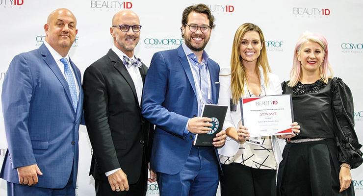 PreHeels accepts the 2017 award for Package Innovation: Personal Care (Prestige). (L-R): Jay Gorga, publisher, Beauty Packaging; Eric Horn, associate executive director-business development, Professional Beauty Association; Adam Kolom, co-founder & CEO, PreHeels, Dana Ward, co-founder & CMO, PreHeels; Daniela Ciocan, marketing director at CPNA