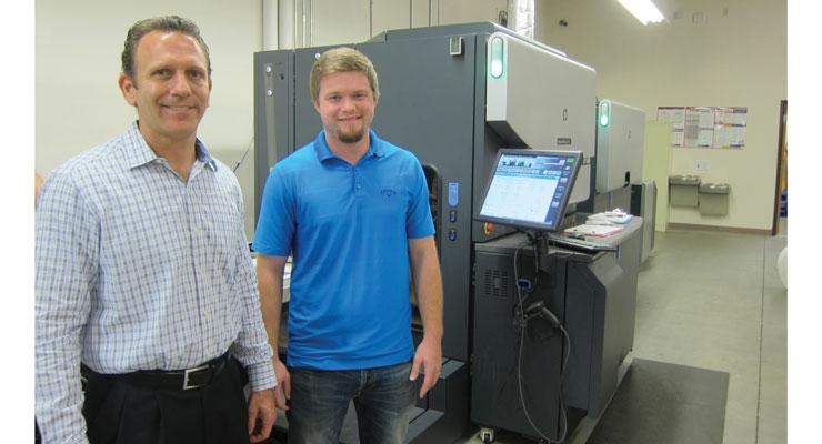 Paul Puleo (L) and Josh Dickson with the HP Indigo WS6800 digital press.