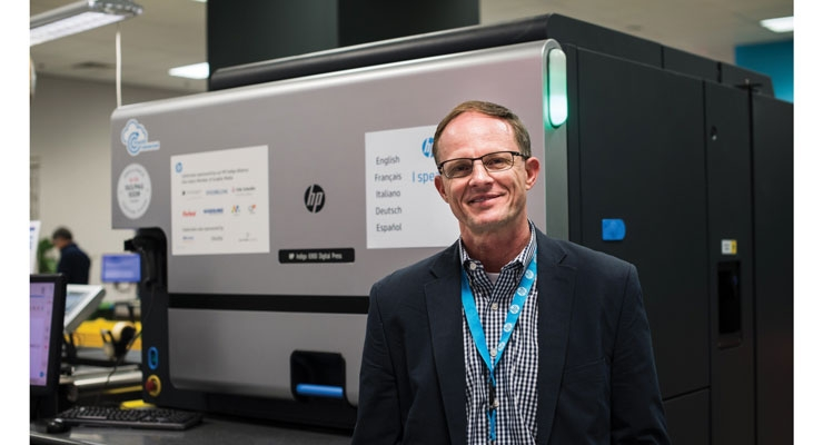 Peter Phaneuf, president of eAgile, stands with the new HP Indigo 6900 digital press.