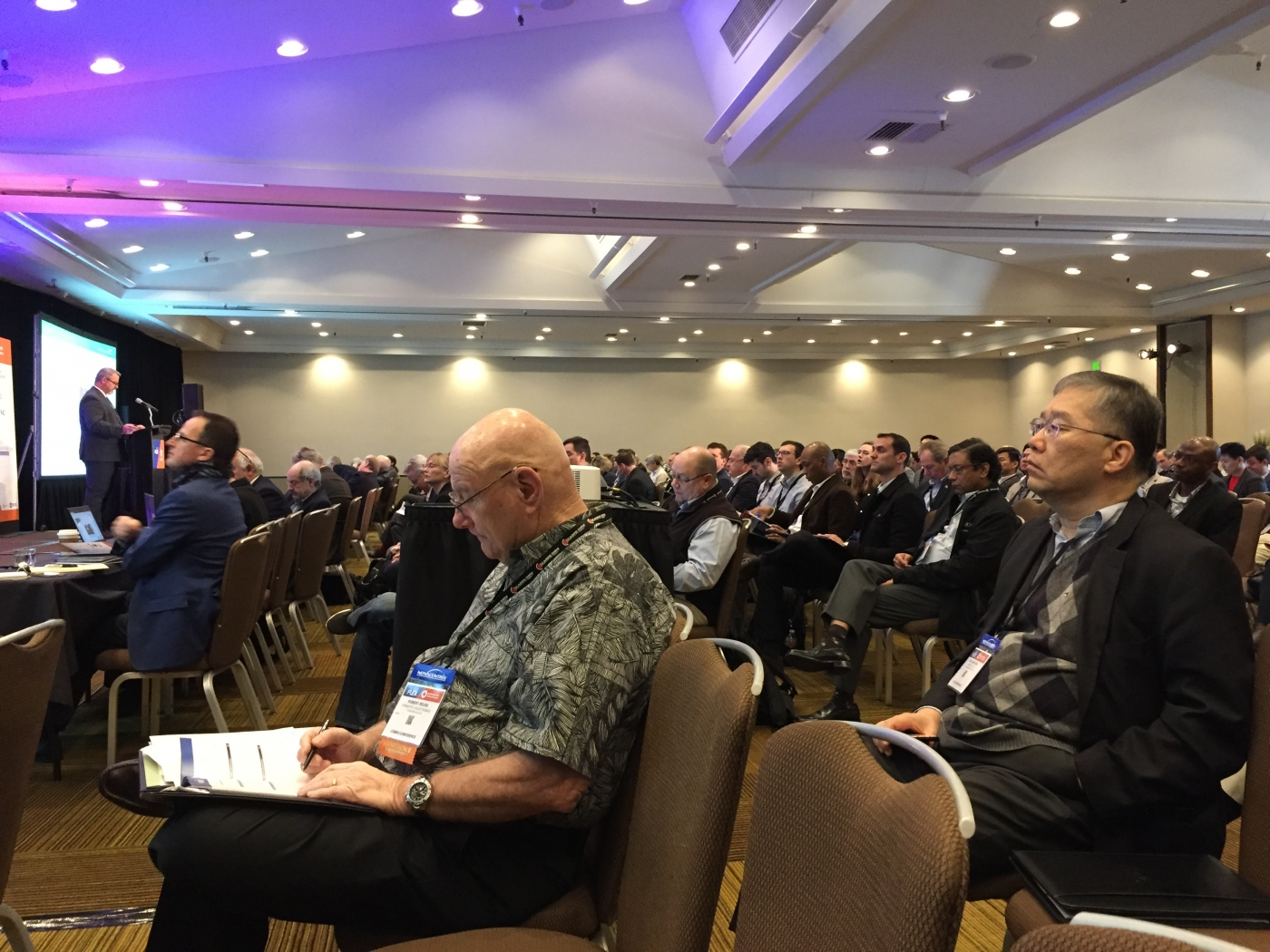 Attendees learn about new developments in flexible hybrid electronics.