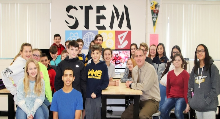 STEM teacher Greg Brovont with his seventh-grade students, one of the classrooms that will benefit from BASF's $9,000 contribution to Wyandotte Public schools.