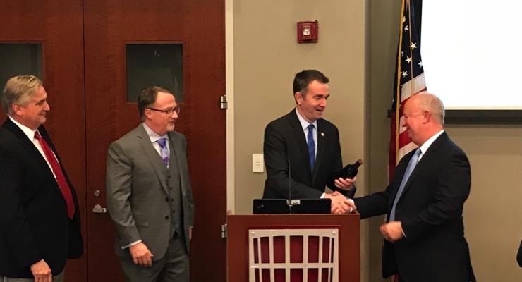 VA Governor Northam presenting a gift to Panaceutics CEO Mark Montgomery. (Photo: Business Wire)