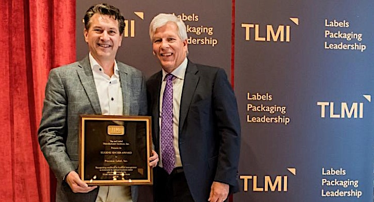 Dave Greiner of Precision Label accepts the Eugene Singer Award from TLMI chairman Craig Moreland.