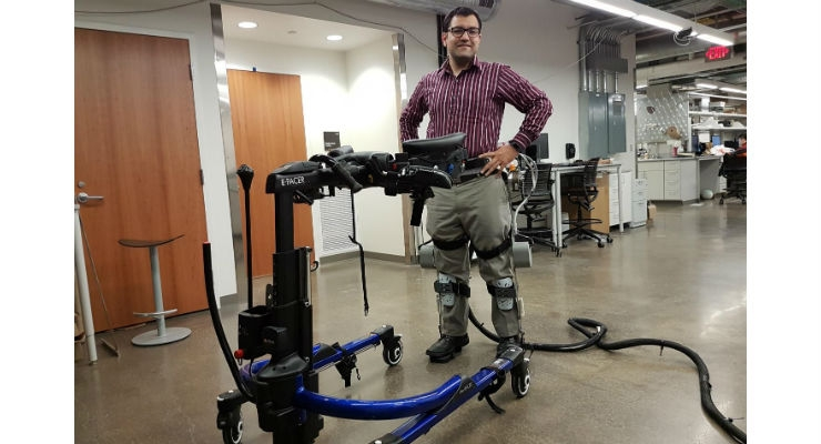 Professor Sharma wearing a lower-limb exoskeleton in his neuromuscular control and robotics laboratory. Image courtesy of Sharma Lab/University of Pittsburgh.