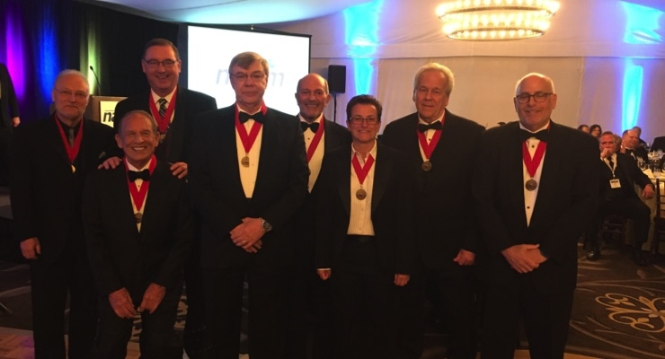 Joining Joseph Cichon, fourth from left, NAPIM's 2018 Ault Award recipient, are past honorees Jim La Rocca, Urban Hirsch III, William Miller, Harvey Brice, Diane Parisi, Rick Clendenning and Jeff Koppelman.
