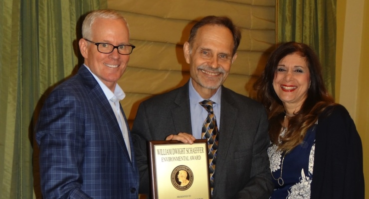 NAPIM's George Fuchs, center, receives the prestigious William D. Schaeffer Environmental Award from Michael Makin, president and CEO of Printing Industries of America, as George's wife Jen looks on. (Source: NAPIM)