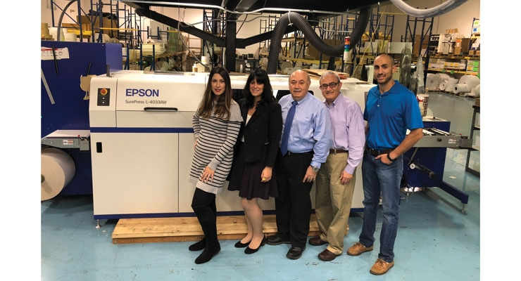From left, Shayda, Sara Shereen, Fari, Farzin and Jon Bakhshian stand with one of SixB's two Epson digital presses.