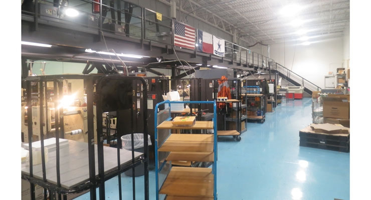 SixB Labels has 14 printing presses, all of which can be accessed from the above catwalk.
