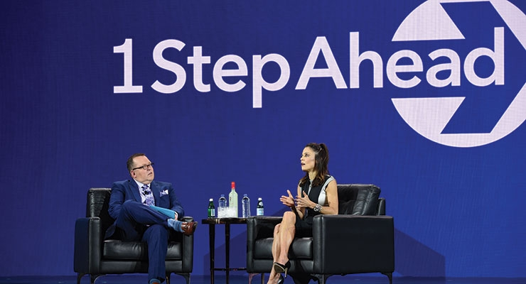 Celebrity entrepreneur Bethenny Frankel presented with IRI's chief  marketing officer John McIndoe at the general session.