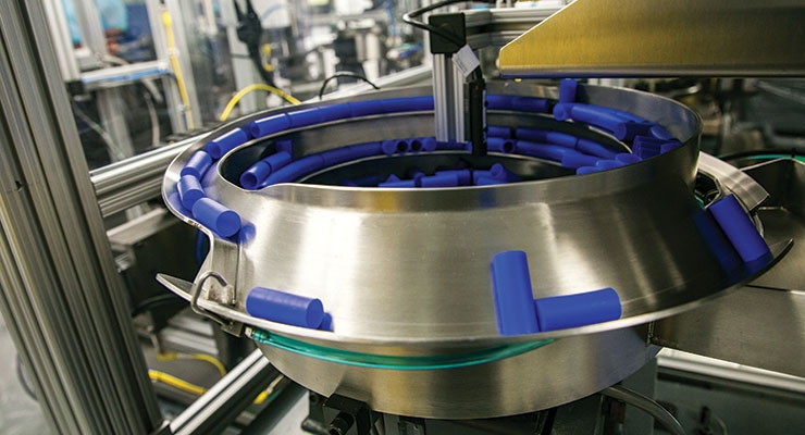 Automated part handling of GW molded parts. Image courtesy of GW Plastics Inc.
