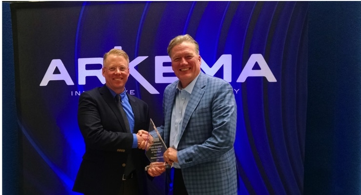 Eric Kaiser (left), regional president for Arkema Coating Resins, North America, presents the 2017 North American Distributor of the Year Award to Ken Moran, president of Peninsula Polymers (right)
