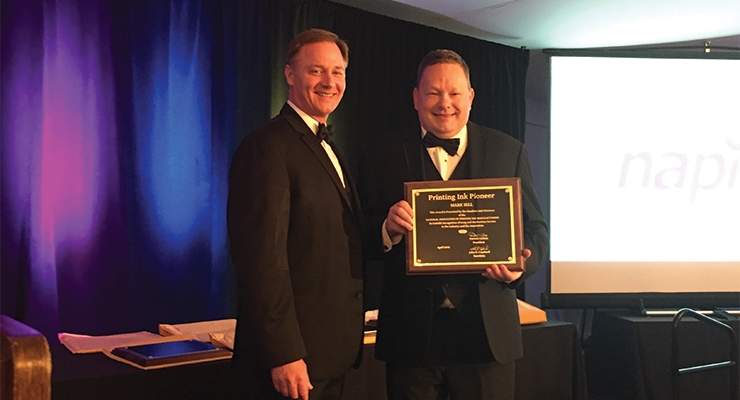 Mark Hill, right, receives NAPIM's Printing Ink Pioneer Award from NAPIM president Pat Carlisle of Joules Angstrom UV Printing Inks.
