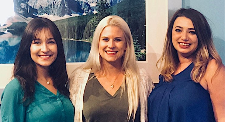 Progressive employees (L)) Ashlee Johnston, marketing associate, Charlotte Smith, production assistant, and Leilani Doolin, managing partner