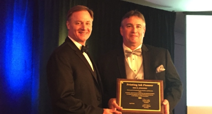 Kris Johansen, right, receives NAPIM's Printing Ink Pioneer Award from NAPIM president Pat Carlisle of Joules Angstrom UV Printing Inks.