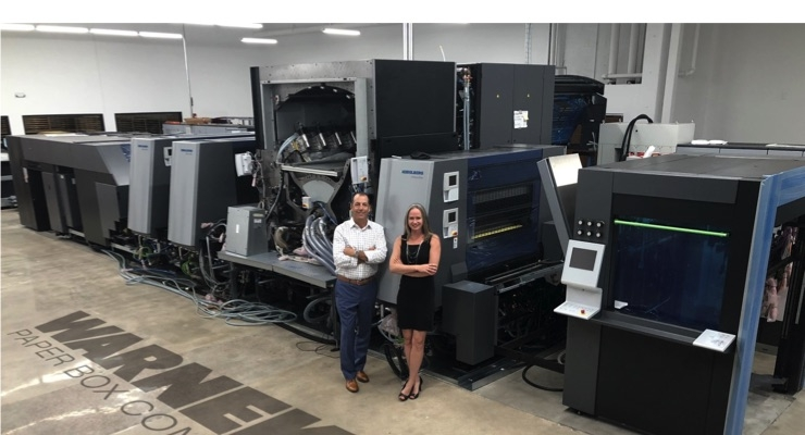 Steve Huppert, VP and COO and Stacy Warneke, president and CEO of Warneke Paper Box, with their new Primefire 106 from Heidelberg. (Source: Heidelberg)