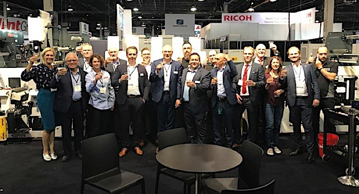 The MPS team toasts the sale of five presses during Labelexpo Americas 2018.