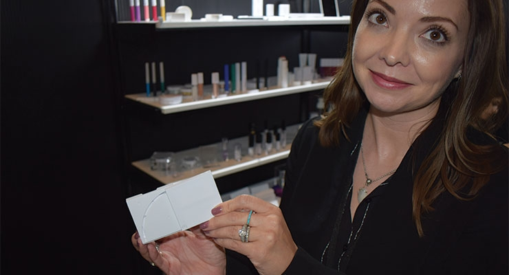 Kristen O'Connell, Roberts Beauty, explains one of their new multi-level compacts.