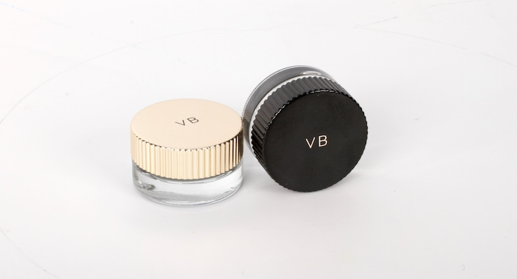 Anomatic worked with Estée Lauder to produce stylish caps in gold and black for Victoria Beckham Aura Gloss.