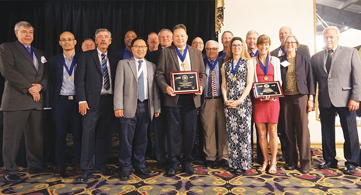 Mark Hill and Kay Sanborn are joined by past honorees after they  received the 2018 NAPIM technical awards.