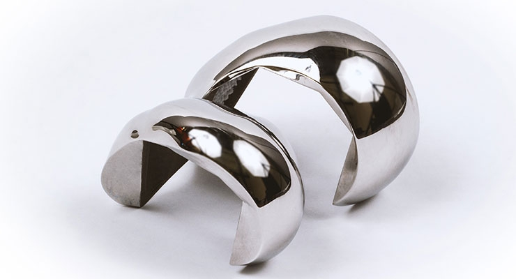 Additively manufactured custom cobalt chrome femoral knee implant. Image courtesy of Precision ADM.