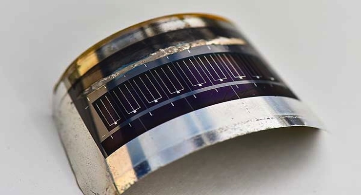 This lightweight CIGS photovoltaic cell, on flexible stainless steel, was made by Matthew Reese and his team at NREL. Photo by Dennis Schroeder/NREL