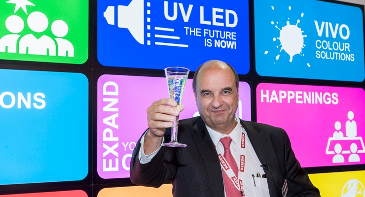 Xeikon CEO Benoit Chatelard toasts a successful Labelexpo.