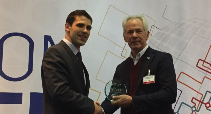 Doug Hackler, right, president and CEO of American Semiconductor, receives the Best IoT Technical Development Award during IDTechEx LIVE 2018.