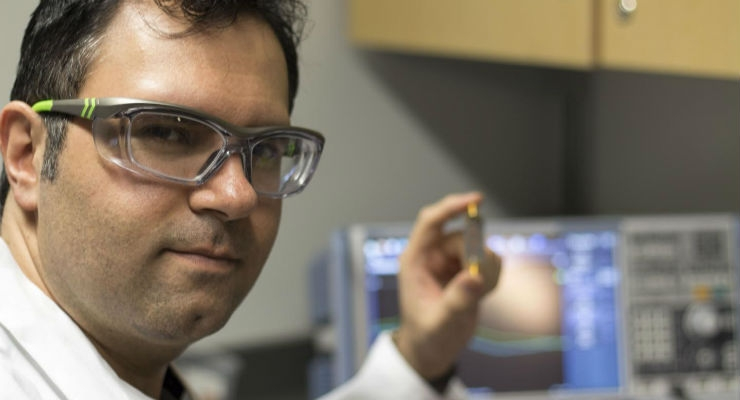 Mohammad Zarifi, an assistant professor at UBC Okanagan, shows his small biosensor that can be used to provide a real-time diagnosis of a bacterial infection. Image courtesy of UBC Okanagan.