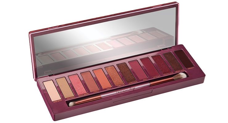 Urban Decay's Naked Cherry Palette is decorated with a row of cherries that match the eyeshadow colors.