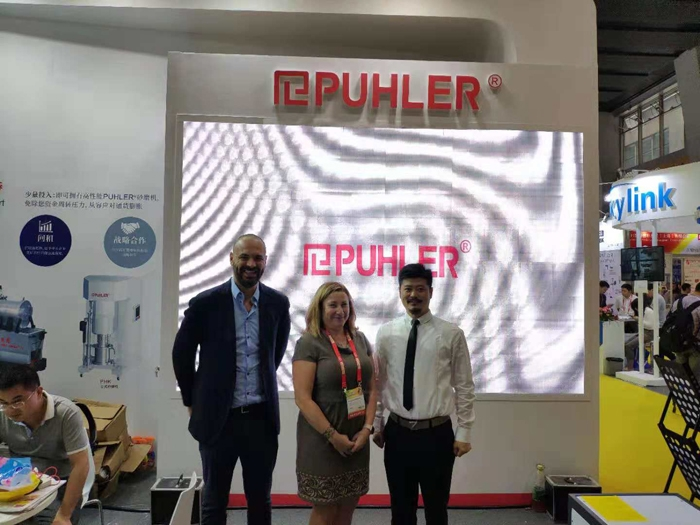 Mirco Nizzolo, technical director, Puhler; Kerry Pianoforte, editor of Coatings World and Dennis Lei, general manager of Puhler.