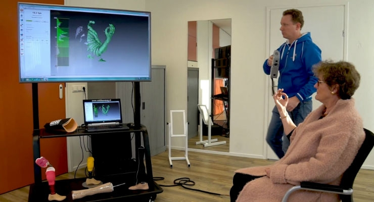 Patient being scanned with a scanner from Artec 3D. Image courtesy of Artec 3D.