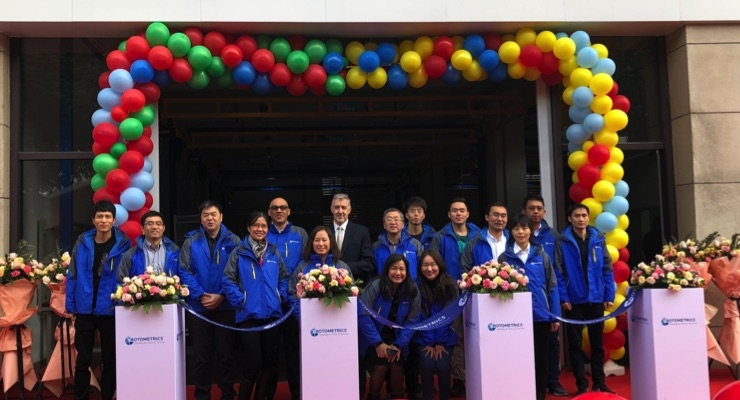Paul McKay (center) and the RotoMetrics China team celebrate the official opening of the new facility in Suzhou