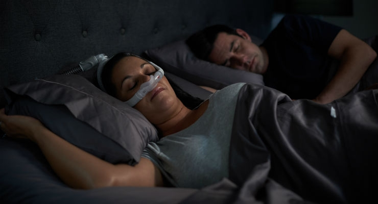 Woman sleeping on side with AirFit N30i nasal CPAP mask. Image courtesy of Business Wire.