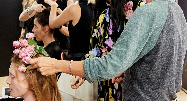 Redken's Guido Palau creates a  romantic floral-topped hairstyle for the Dolce & Gabbana runway show at New York Fashion Week.
