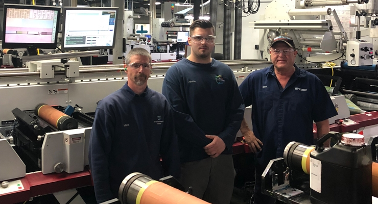From left, press operator and instructor Mark Zastow with high school program alumni Dakota Meyer and Justin Krausslach. Both Dakota and Justin now work at WS Packaging Group as a press operator and ink technician, respectively.