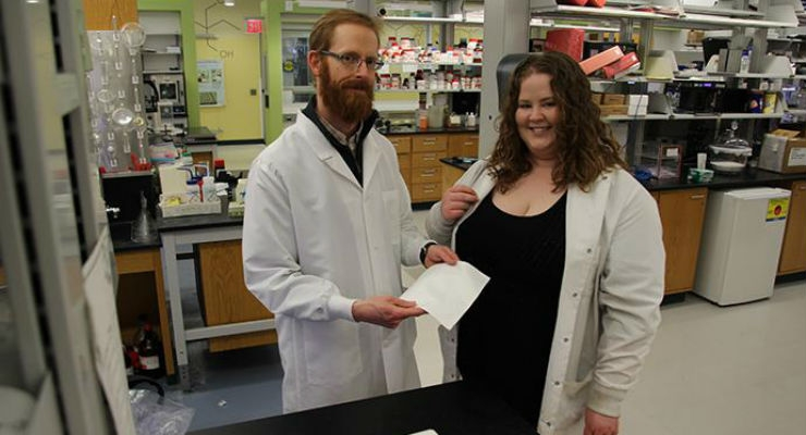 Professor James H. Henderson and Ph.D. candidate Shelby L. Buffington of Syracuse University display the new shape memory polymer in their lab. Image courtesy of Syracuse University.