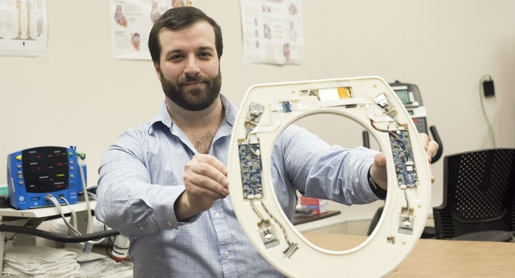 Nicholas Conn, a postdoctoral fellow at RIT and founder and CEO of Heart Health Intelligence, is part of the university team that has developed a toilet-seat based cardiovascular monitoring system. Image courtesy of A. Sue Weisler/RIT.