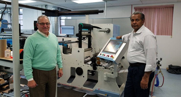 Label Graphics founder, owner and president Tom Silvano (L) and General Manager Ali Khan with the company's new flexo press.