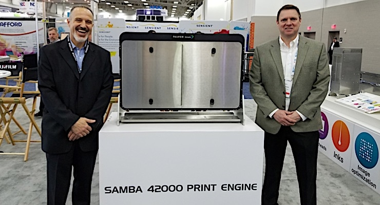 Gary Barnes (L) and Scott Leger discuss the latest printing and ink technologies at Fujifilm.