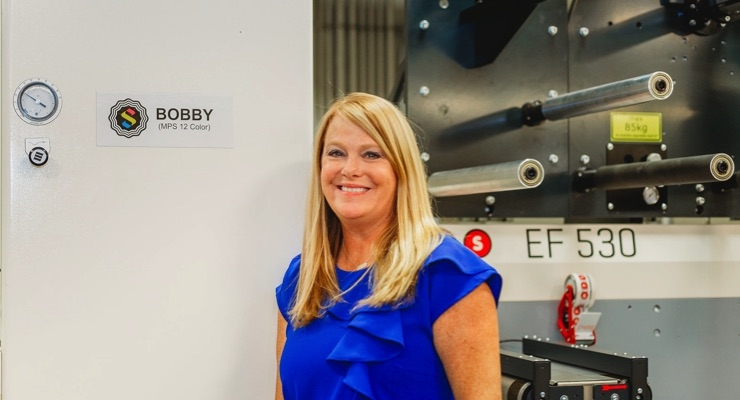 "CEO/Owner Tara Halpin proudly christens her new 12-color MPS press ""Bobby"" after her late father and third-generation owner, Robert ""Bobby"" Steinhauser."